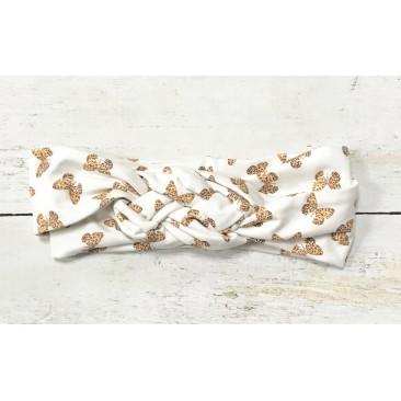 Balta galvajuostė su drugeliais